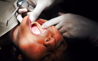 Dental Care International (DCI) mobile dental clinic. Children receive free dental care