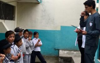Dental Care International (DCI) Ecuador Dental Volunteer service trip. oral hygiene lesson.