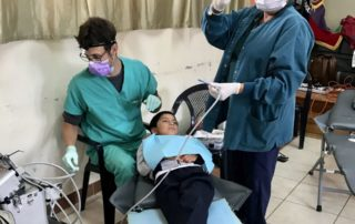 Dental Care International (DCI) Ecuador Dental Volunteer service trip. Dentist and Hygienist working together