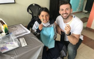 Dental Care International (DCI) Ecuador Dental Volunteer service trip. free toothbrushes.